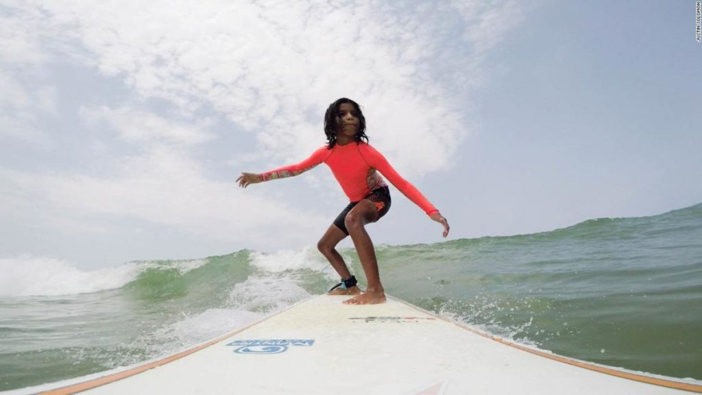 A kid surfing in India
