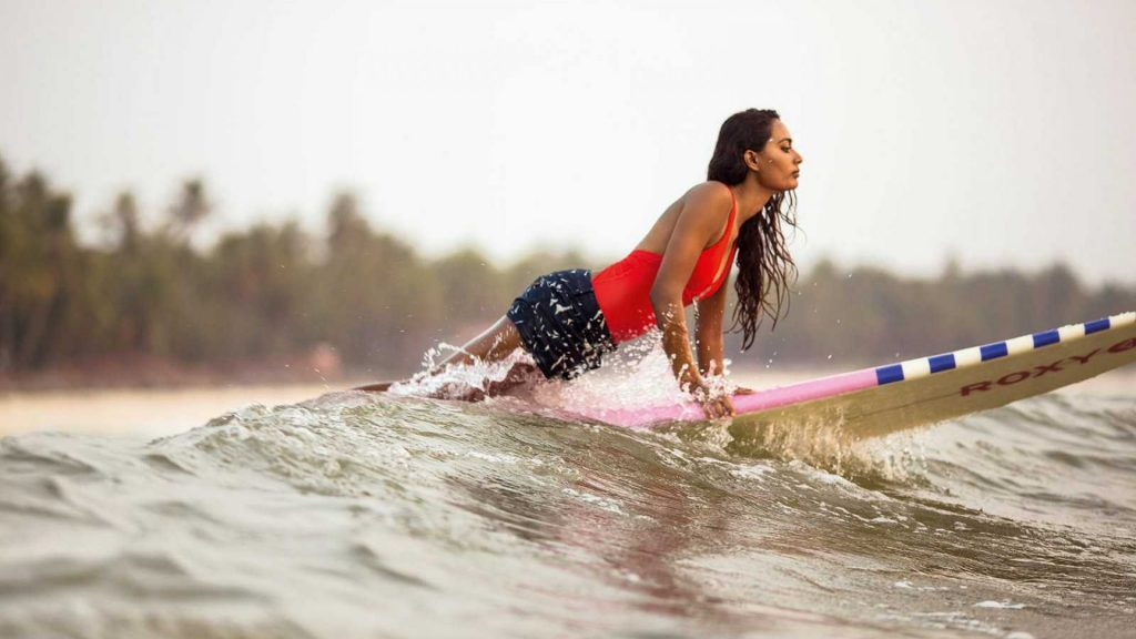 a girl having fun on surfboard