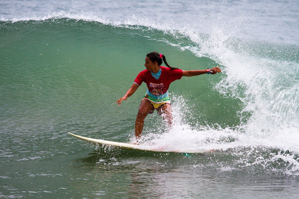 a women surfing