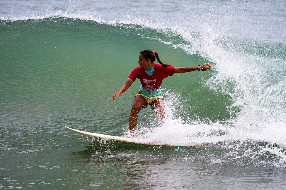 a women surfing