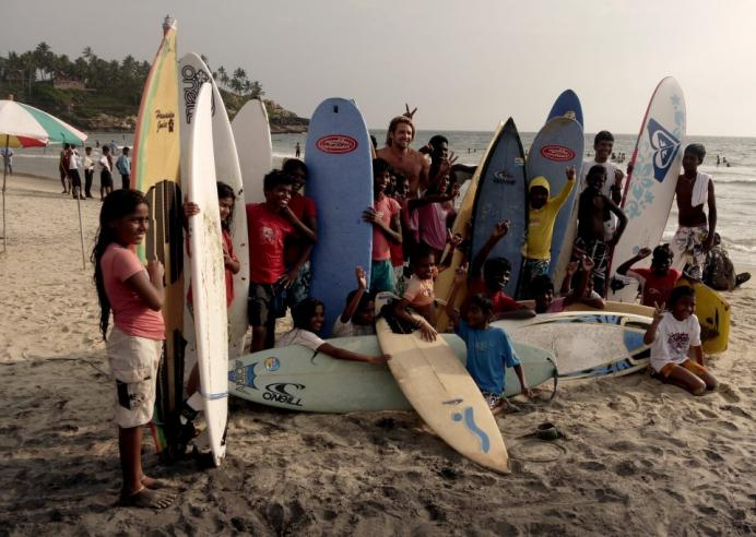 kids learn surfing in india