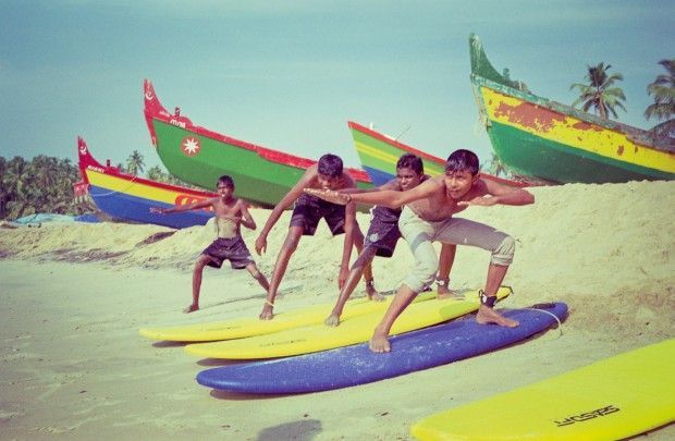 kids learning surfing techniques in India