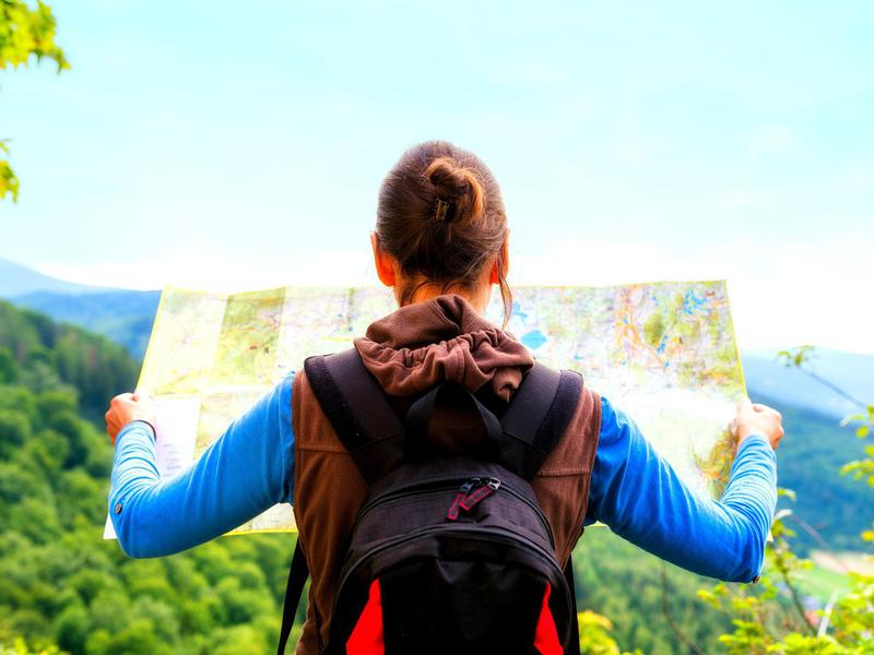 women seeing the map while traveling