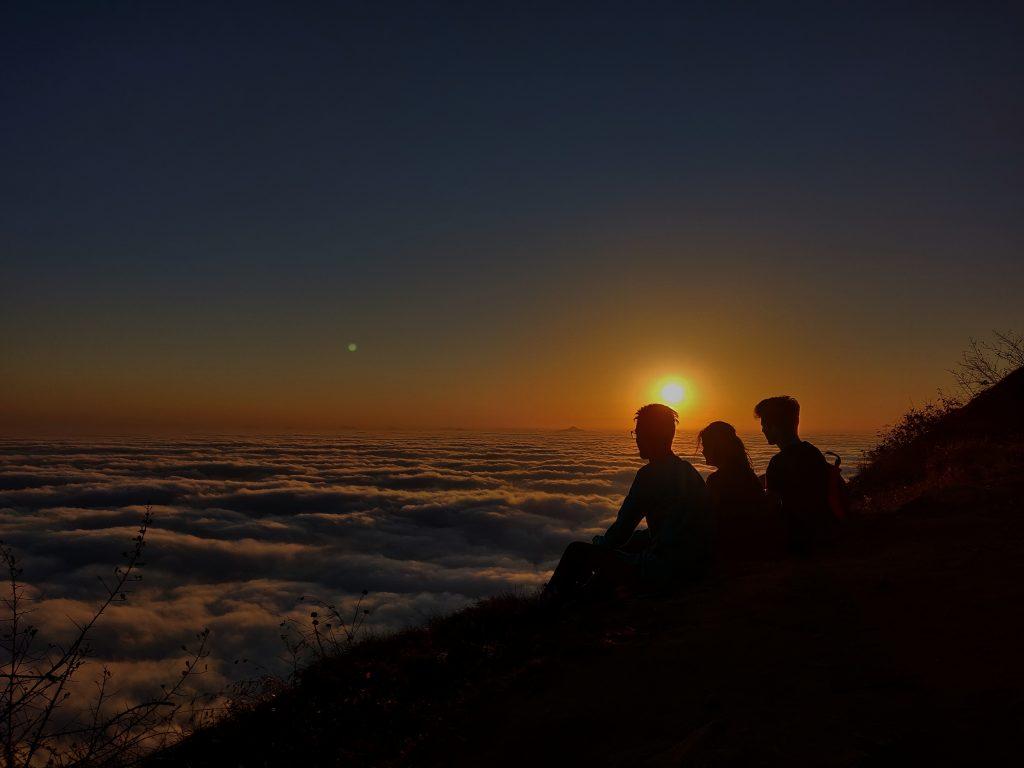 friends watching sunrise from skandagiri hills