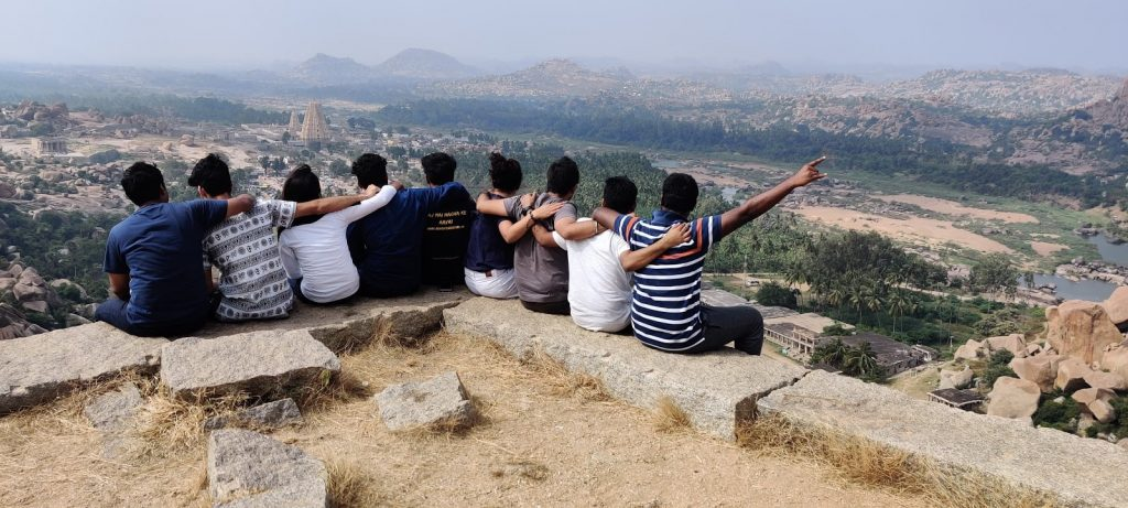 People enjoying the view from the top during the Hampi trip