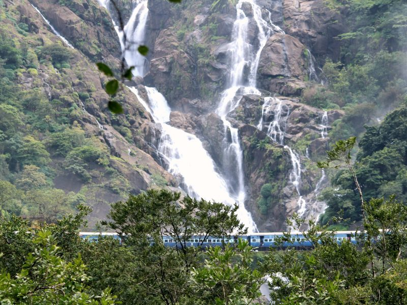 Train moving in front of Dudhsagar falls